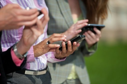 Group of people texting outside
